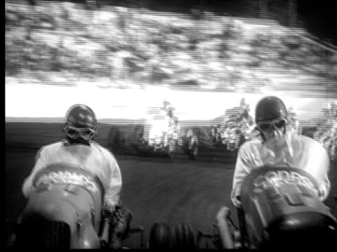 1947 B/W MONTAGE MS CU POV PAN Car race with car loosing control and breaking through wooden fence, USA, AUDIO