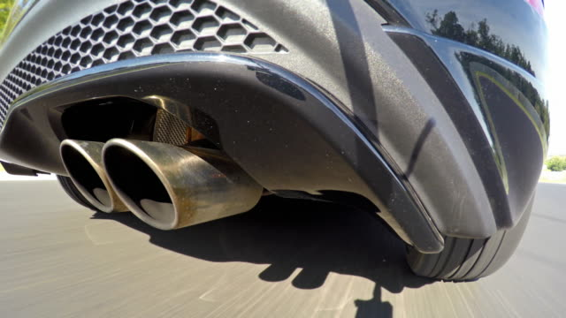 Car racing at a sports track, view of exhaust pipe