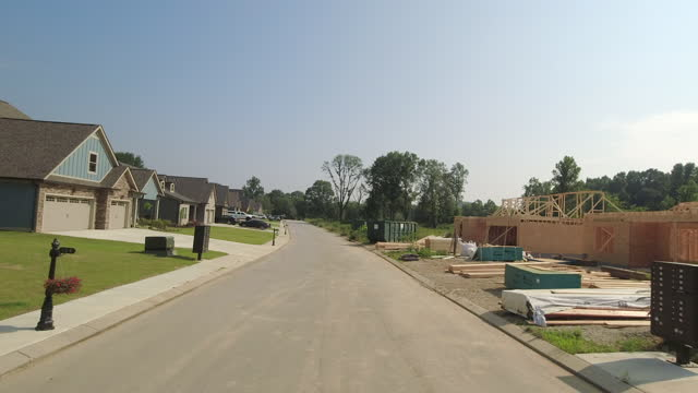 car rear point of view of new subdivision homes under construction in atlanta suburb in the summer of 2021. - new stock videos & royalty-free footage