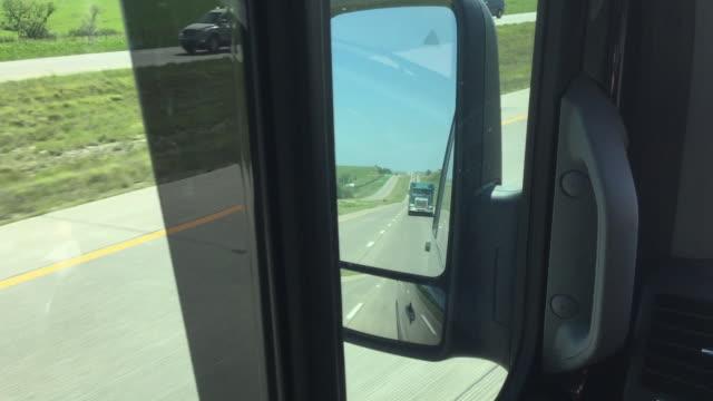 vídeos de stock, filmes e b-roll de car rear side view of oil tanker and trucks on the highway - estrada principal estrada
