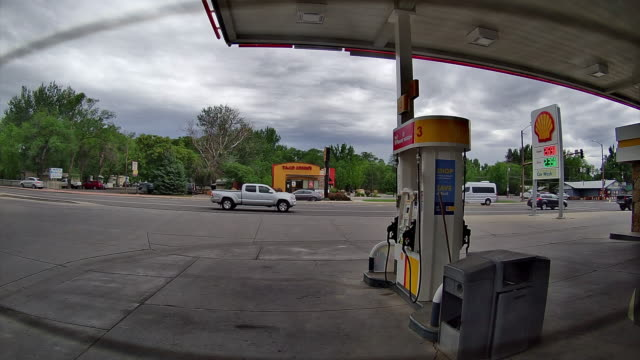 car rear view of shell gas station opening for business in montrose, colorado, usa amid the 2020 global coronavirus pandemic - refuelling stock videos & royalty-free footage
