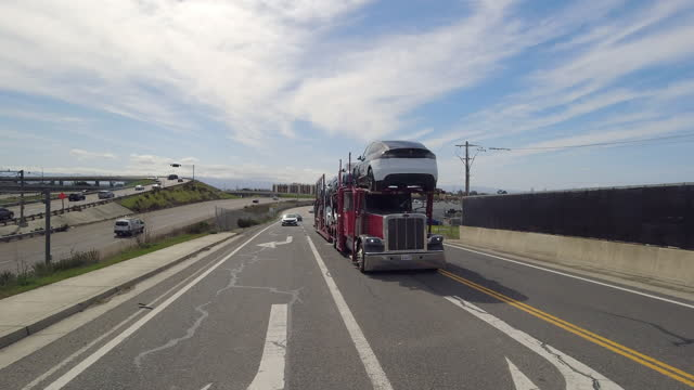 car rearview of tesla new cars are being transported on the highway in palo alto, california, on march 24, 2021. - new stock videos & royalty-free footage