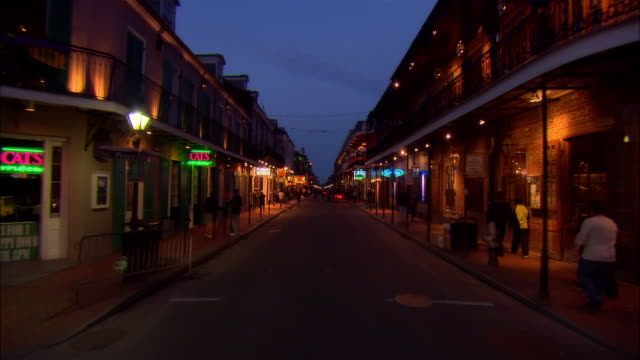 POV car riding on Bourbon Street at night, New Orleans, Louisiana, USA
