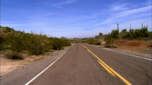 REAR POV, Car riding on desert highway, Arizona, USA