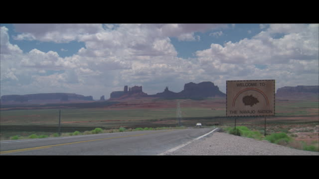 ws, pan, car riding on highway, passing sign welcome to navajo nation, arizona, usa - navajo culture stock videos & royalty-free footage