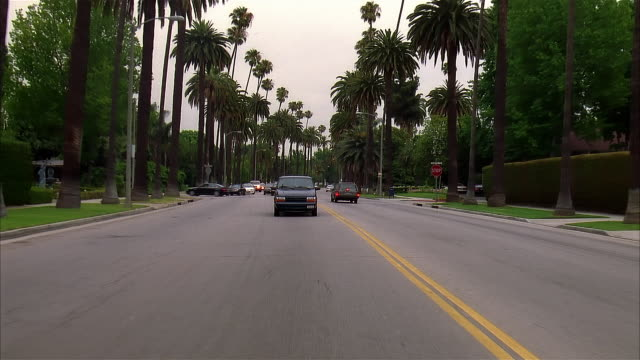 rear pov car riding on road, beverly hills, california, usa - 2004 stock-videos und b-roll-filmmaterial