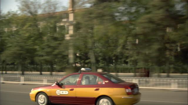 pov, car riding through city, beijing, china - moving past stock videos & royalty-free footage