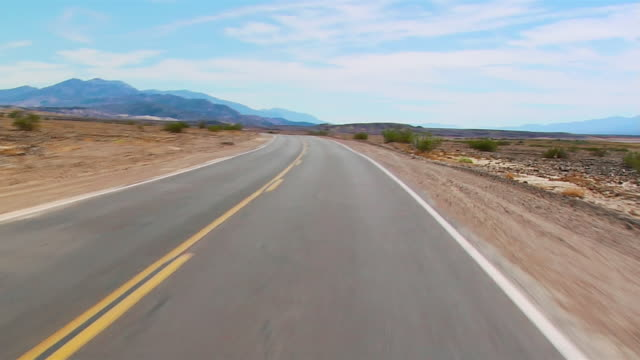 pov car riding through death valley, california, usa - winding road stock videos & royalty-free footage