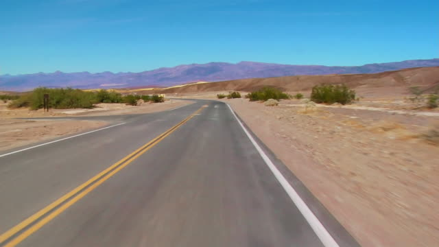 POV car riding through Death Valley, California, USA