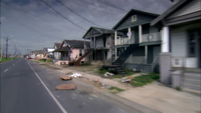 POV car riding through destroyed residential area, Gentilly, New Orleans, Louisiana, USA