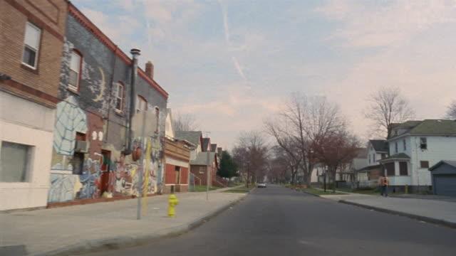 SIDE POV car riding through run down neighborhood, Rochester, New York, USA
