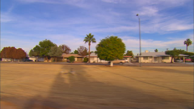 side pov, car riding through suburban area, tucson, arizona, usa - arizona cactus stock videos & royalty-free footage