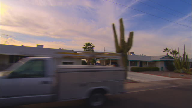 side pov, car riding through suburban area, tucson, arizona, usa - arizona stock-videos und b-roll-filmmaterial