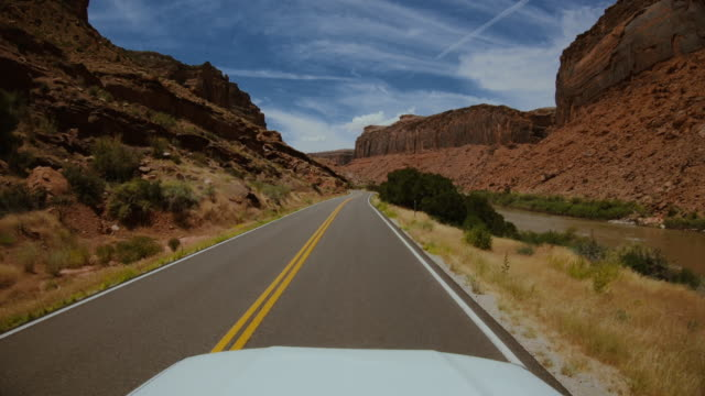 pov car road driving by the colorado river: southwest usa - southwest usa stock videos and b-roll footage