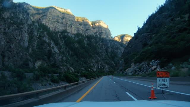 pov car road rocky mountain pass near denver - denver stock videos & royalty-free footage