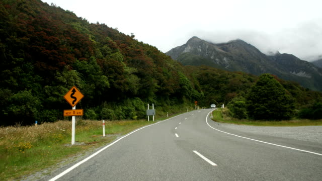 t/l car pov of roads in arthurs pass national park, new zealand - car point of view stock videos & royalty-free footage