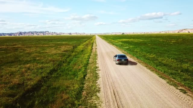 car running in the badlands national park - south dakota - badlands national park stock videos & royalty-free footage