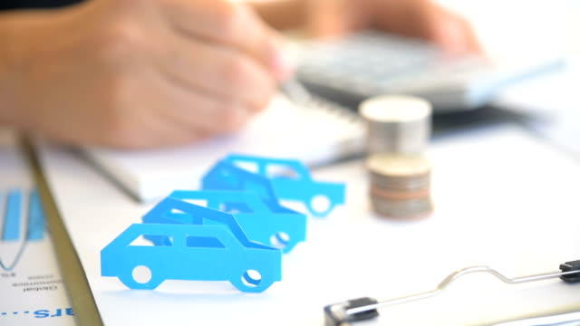 car shape paper cut on office table - file stock videos & royalty-free footage
