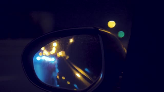 car side mirror in bangkok city night. - car interior stock videos & royalty-free footage