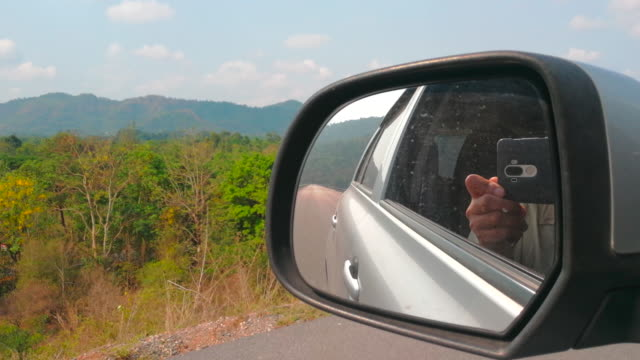 car side mirror shot by smart phone - shaking stock videos & royalty-free footage