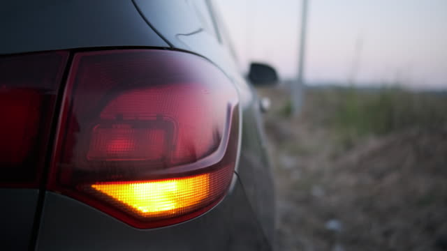 car signal emergency stop on the freeway dusk - blinking stock videos & royalty-free footage