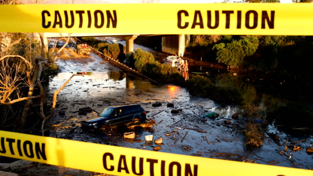A car sits in mud and debris on Highway 101 after a mudslide on January 10 2018 in Montecito California 17 people have died and hundreds hundreds of...