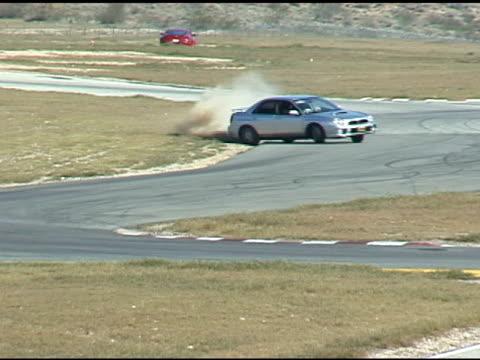 Car Skids Off Race Track