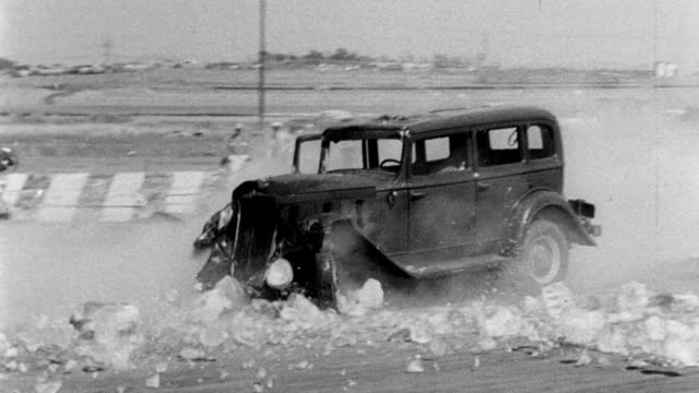 car smashes through a wall of stacked blocks or bricks hollywood stuntmen display skills on june 05 1951 in hollywood california - classic car stock videos and b-roll footage