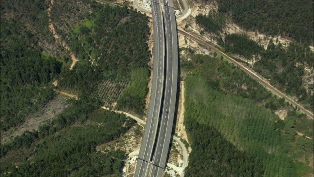 AERIAL WS TS Car speeding on motorway / Pombal, Leria, Portugal