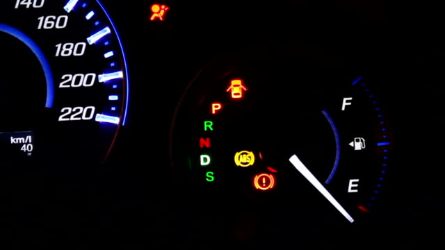 car speedometer and fuel gauge on dashboard at night - fossil fuel stock videos & royalty-free footage