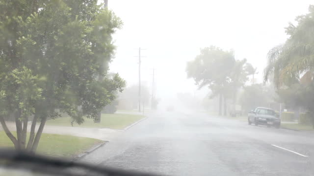 car stopped on roadside stuck in rain windscreen wipers on - side view stock videos & royalty-free footage
