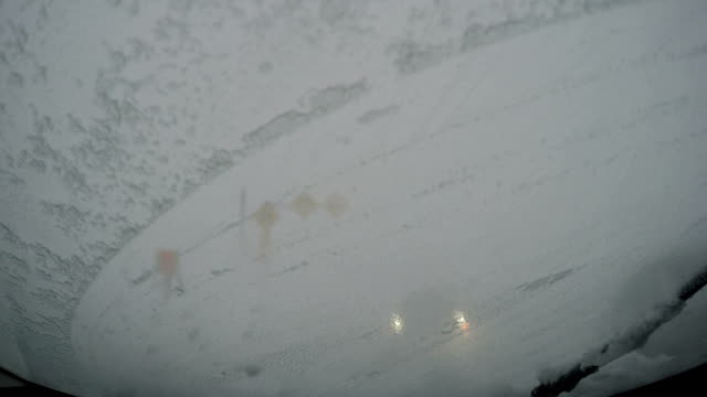 car stranded in white out zero visibility blizzard conditions in japan - 深い雪点の映像素材/bロール