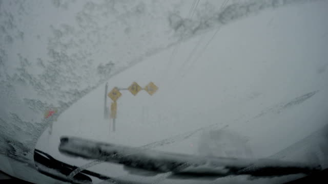 Car stranded in white out zero visibility blizzard conditions in Japan
