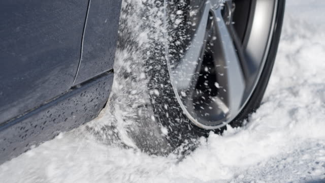 car stuck in winter, spraying snow over camera - spinning stock videos & royalty-free footage