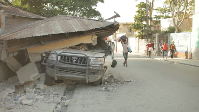 A car submerged under the debris caused by the Haiti earthquake of January 2010