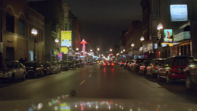 a car swerves on a chicago street at night. - chicago illinois stock videos & royalty-free footage