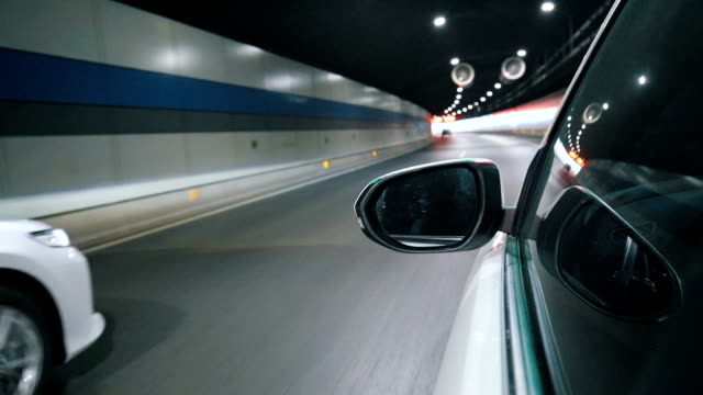 car through a road tunnel - wing mirror stock videos & royalty-free footage