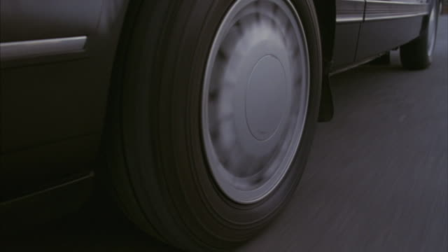 A car tire accelerates, brakes, and skids to a stop.