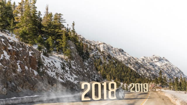 Car tires rolling on a snow between 2018 to 2019