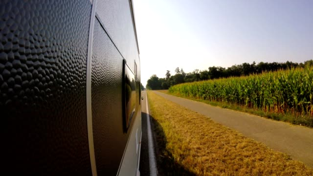 pov: car towing a caravan on german road in countryside - tunnel stock videos & royalty-free footage