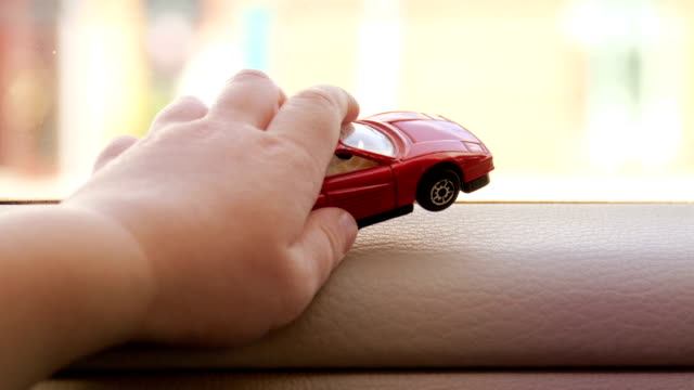 Car toy in baby hand