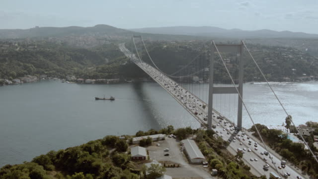 aerial car traffic traveling along the bosphorous bridge / istanbul, turkey - july 15 martyrs' bridge stock videos & royalty-free footage