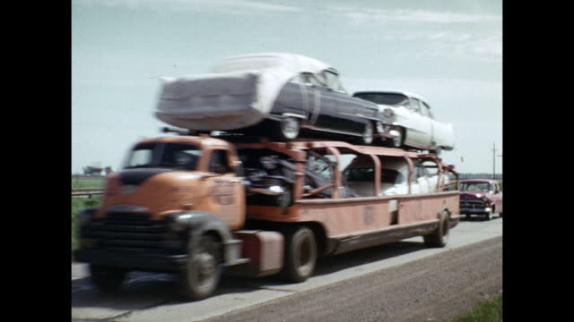 vidéos et rushes de 1954 home movie car transport trucks driving past on country road / united states  - 1954