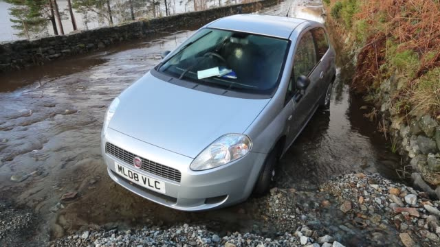 car trapped between two landslides on the a591, the main road through the lake district, which was completely destroyed by the floods from storm... - road closed englisches verkehrsschild stock-videos und b-roll-filmmaterial