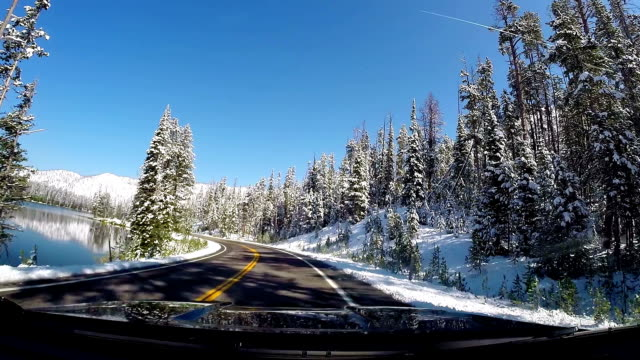 car travel - bright winter day - robin day stock videos & royalty-free footage