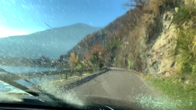 Car Travel on a Mountain Road and Using Windshield Wiper