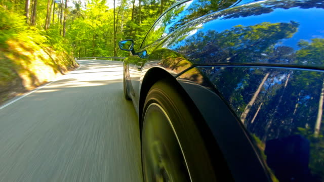 car travel on an empty scenic winding road, side view - curve stock videos & royalty-free footage