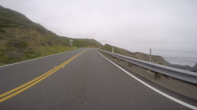 a car traveling on a rural road in northern california. - coastal road stock videos & royalty-free footage