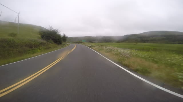 a car traveling on a rural road in northern california. - car point of view stock videos & royalty-free footage