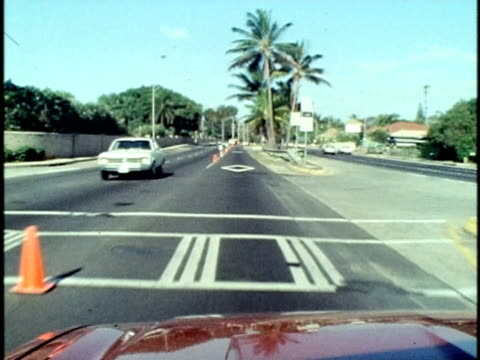 1975 ws pov car travelling along a traffic cone-lined high occupancy vehicle lane and passing traffic on the far side/ oahu, hawaii islands, usa/ audio - traffic cone stock videos & royalty-free footage